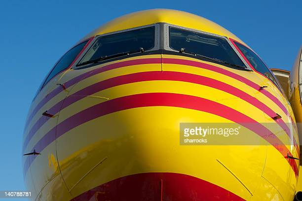 Nose of yellow and red aircraft