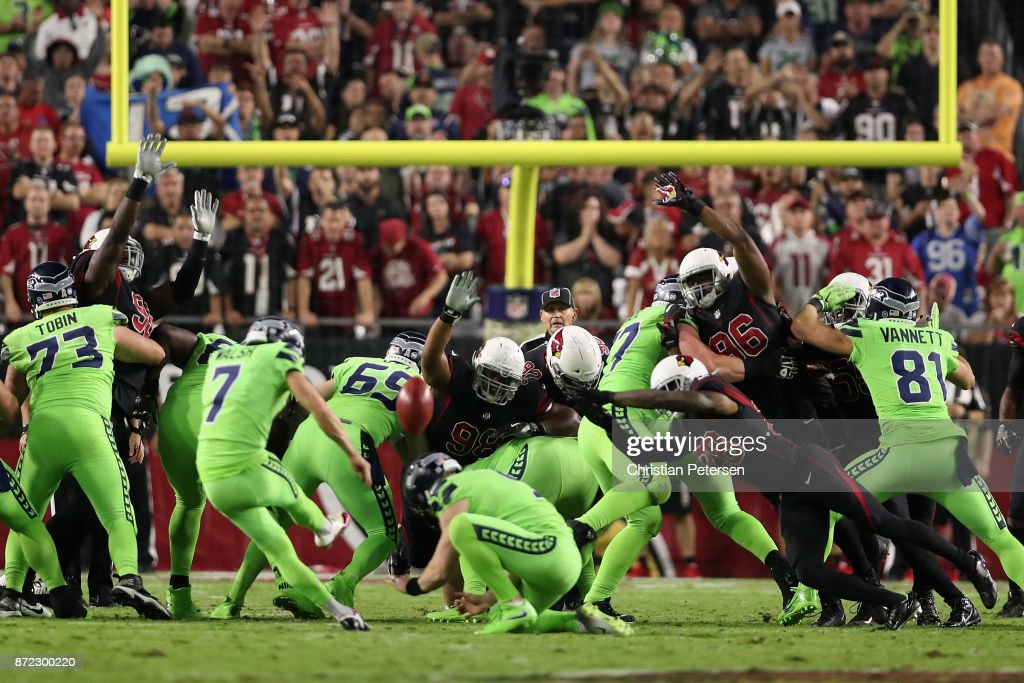 Nose tackle Corey Peters #98, inside linebacker Kareem Martin #96 and cornerback Justin Bethel #28 of the Arizona Cardinals attempt block a field goal kicked by kicker Blair Walsh #7 of the Seattle Seahawks during the first half of the NFL game at the University of Phoenix Stadium on November 9, 2017 in Glendale, Arizona.