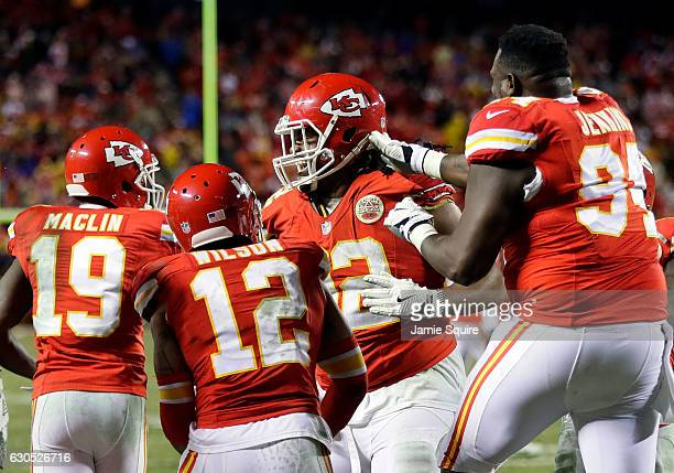 Nose tackle Dontari Poe of the Kansas City Chiefs celebrates with teammates after passing for a touchdown during the 4th quarter of the game against...