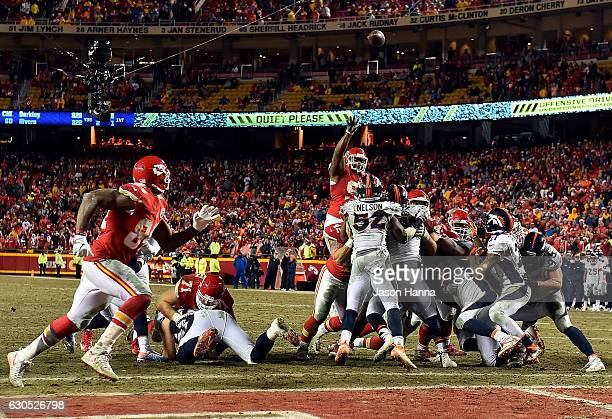 Nose tackle Dontari Poe of the Kansas City Chiefs passes to tight end Demetrius Harris in the end zone for a touchdown during the 4th quarter of the...