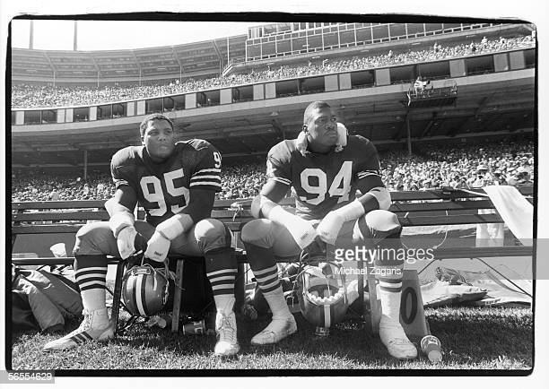 Nose tackle Michael Carter and defensive end Charles Haley of the San Francisco 49ers sit on the bench against the Indianapolis Colts at Candlestick...
