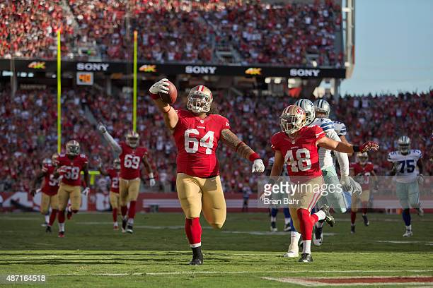 Nose tackle Mike Purcell of the San Francisco 49ers scores a 37yard touchdown on an interception against the Dallas Cowboys in the second quarter of...