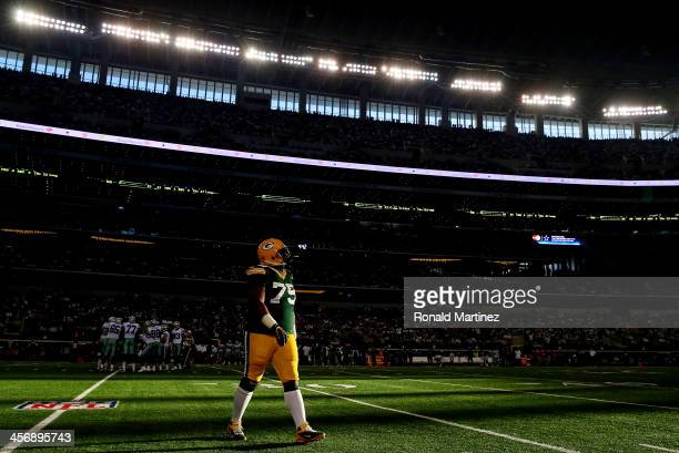 Nose tackle Ryan Pickett of the Green Bay Packers walks off the field against the Dallas Cowboys during a game at AT&T Stadium on December 15, 2013...