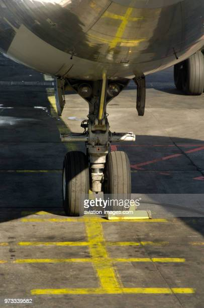 Nosewheel undercarriage with a choke of an American Airlines Airbus A300600R parked on apron markings