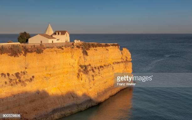 Nossa Senhora da Rocha Chapel, rocky coastline, Armacao de Pera, Algarve, Portugal