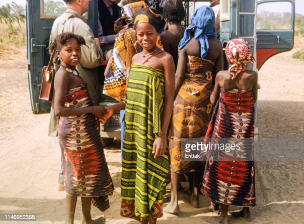 nostalgia. cameroon 1965. curious young cameroon women behind tourist jeep. tourist getting into the jeep. - cameroon stock pictures, royalty-free photos & images