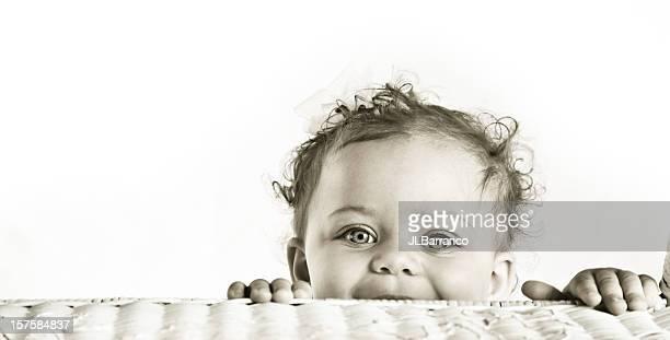 Nostalgic Finish Image of Baby Girl Playing Peek a Boo