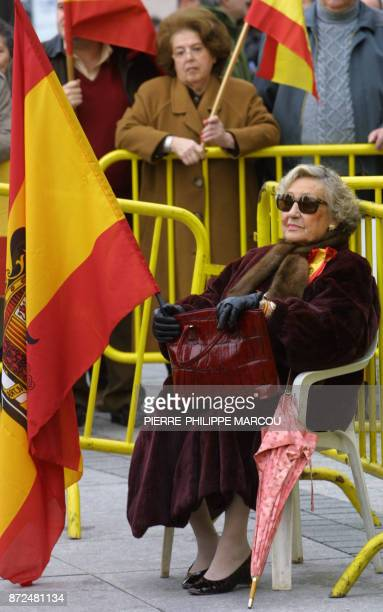 A nostalgic woman with the flag used during Franco's government commemorates the 26th anniversary of the death of the Spanish dictator Francisco...