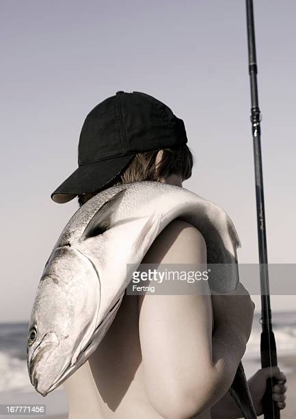 Nostalgically styled photo of a young surf fisherman