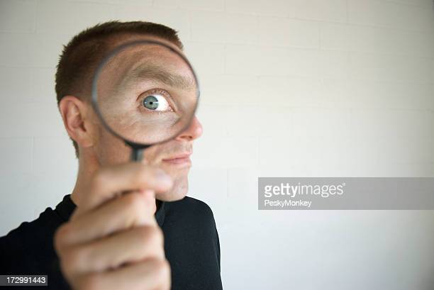Nosy Man Invading Privacy with Magnifying Glass