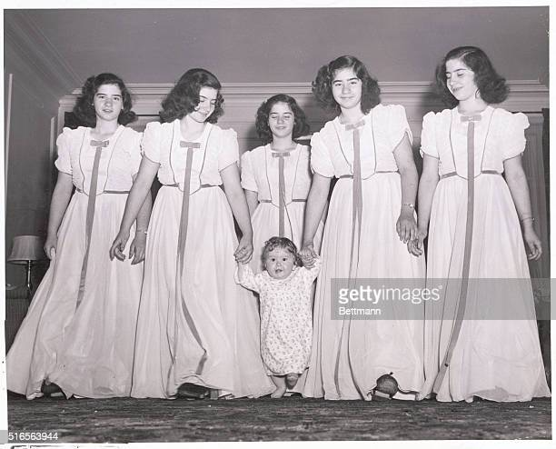 Not all dressed up but rarin' to go young Joseph leads his sisters in a merry chase across the living room rug Front left to right the Quints all...