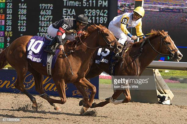 Not Bourbon jockey Jono Jones looks over to challenger Ginger Brew as the horses cross the line during the 149th Queens Plate Sunday at Woodbine...