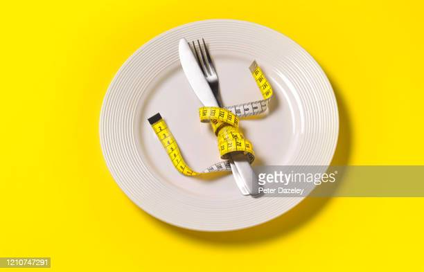 not eating, fasting diet, anorexic issues - eating disorder stock pictures, royalty-free photos & images