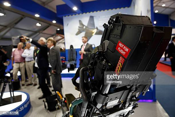 A 'Not For Flight' warning sticker sits on the side of an ejector seat used in the Lockheed Martin Corp F35 Lightning II joint strike fighter jet as...