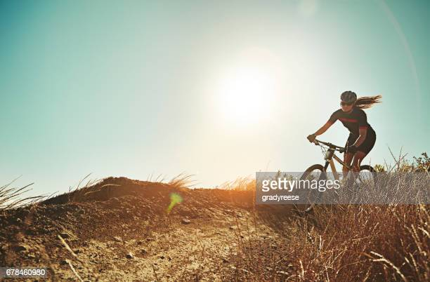 not for the weak of will - cross country cycling stock pictures, royalty-free photos & images