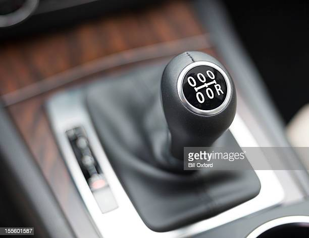 not getting ahead? - gearshift stock photos and pictures
