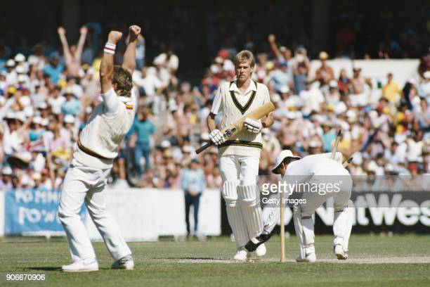 Not out Australia batsman Bruce Reid looks on as slip Ian Botham and wicketkeeper Jack Richards celebrate after Merv Hughes is dismissed as England...
