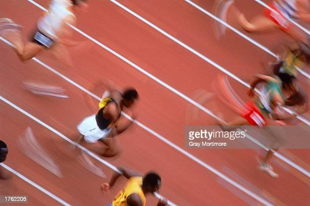 Male sprinters running elevated view