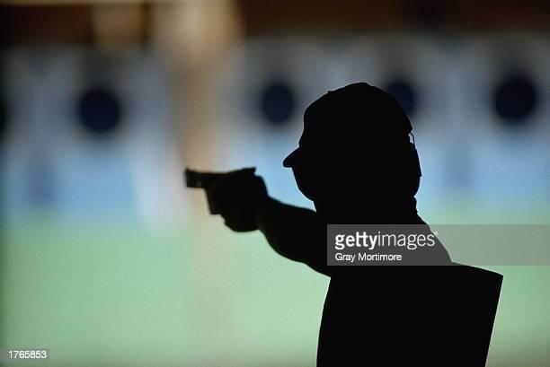 Target shooting person aiming handgun silhouette