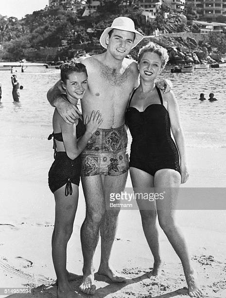 Not Thinking of a White ChristmasOlympic star Bob Mathias enjoys the company of film stars Debbie Reynolds and Celeste Holm on the beach at Acapulco...