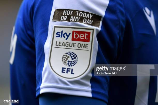 Not Today or Any Day' logo is seen next to the EFL badge during the Sky Bet League One match between Gillingham and Oxford United at MEMS Priestfield...