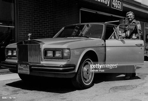 Not Your Basic Economy Model Ken Mausolf, owner of Ken Mausolf Classic Cars, poses with the 1981 Rolls-Royce Silver Spur that carries a list price of...