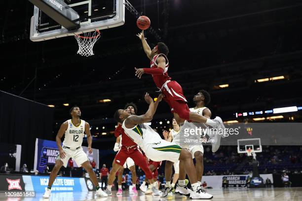 Notae of the Arkansas Razorbacks attempts the layup against the Baylor Bears during the first half in the Elite Eight round of the 2021 NCAA Men's...