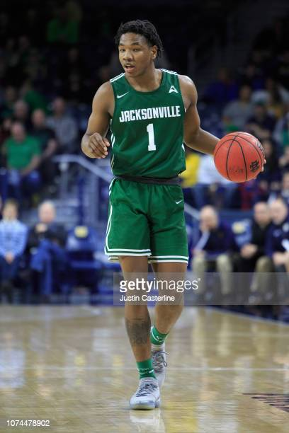 Notae of the Jacksonville Dolphins brings the ball up the court in the game against the Notre Dame Fighting Irish in the second half at Purcell...