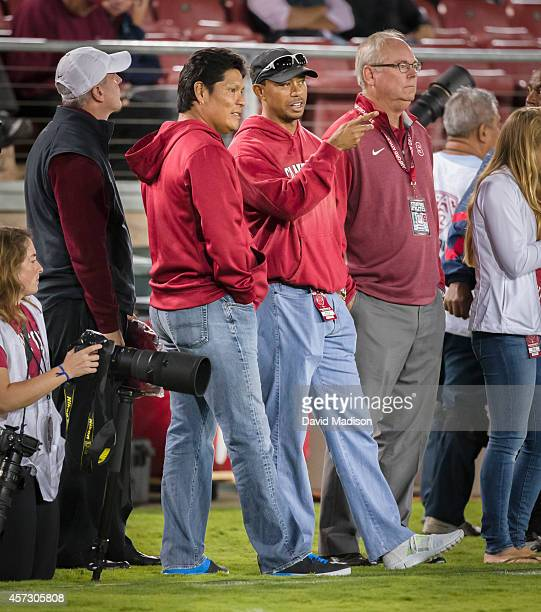 Notah Begay and Tiger Woods watch the Stanford Cardinal football game against the Washington State Cougars on October 10 2014 at Stanford Stadium on...