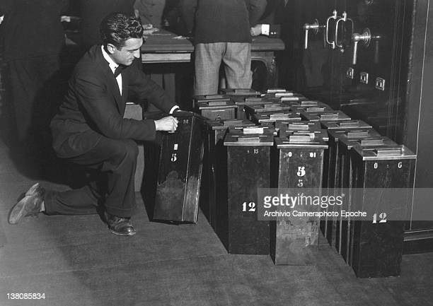 Notaries shelving bills' boxes in the San Remo Casino vault 1950