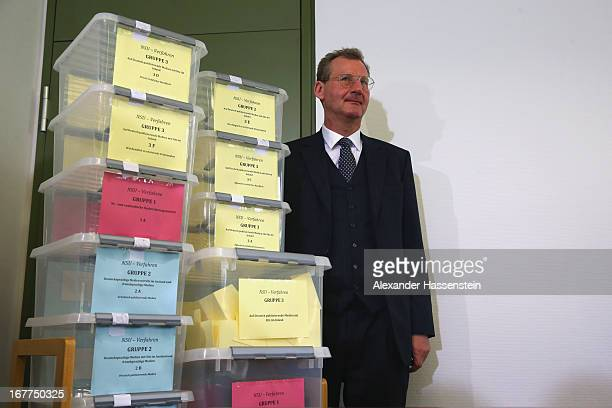 Notary Dr Dieter Mayer stands next to the lottery boxes after a press conference following the lottery draw for the 50 media spots inside the...