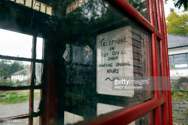 Note advises people that a telephone is available in the one shop in Inverie on the Knoydart peninsular in the Scottish Highlands on May 20, 2021. -...