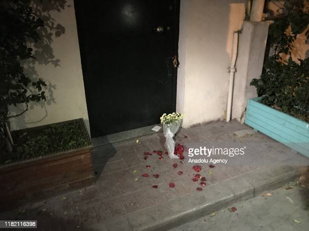A note and a bouquet of flowers are left at a door step after former British military intelligence officer James Gustaf Edward Le Mesurier was found...