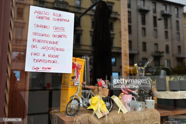 A note at a cafe reads We are closed until further notice on Corso Buenos Aires main street in Milan on March 12 as Italy shut all stores except for...