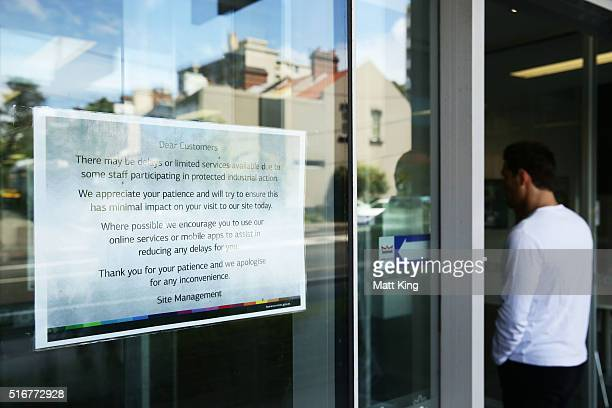 A note explaining possible delays due to staff industrial action appears outside a Medicare and Centrelink office at Bondi Junction on March 21 2016...