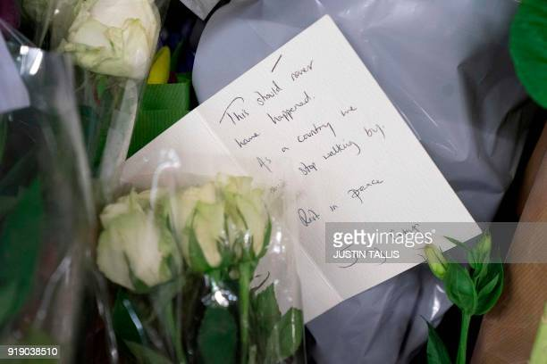 A note from the main opposition Labour Party leader Jeremy Corbyn is seen at a collection of votive flowers where an unnamed Portuguese man was found...