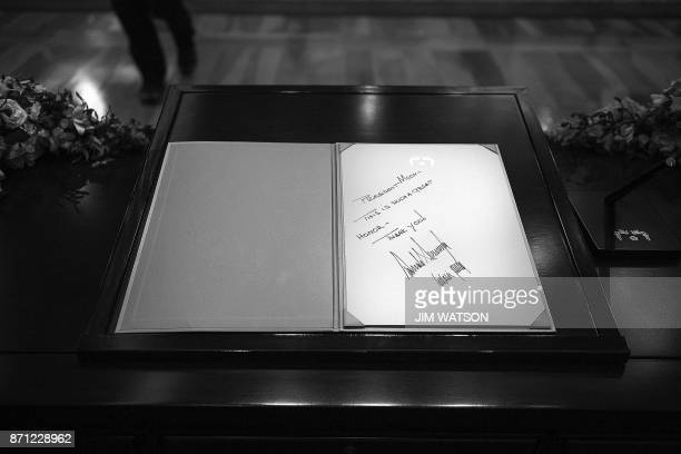 A note from US President Donald Trump and First Lady Melania Trump is seen in the guest book in the presidential Blue House in Seoul on November 7...