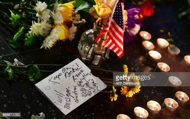 Note left by fans is placed among candles, flowers and a US flag on the Hollywood Walk of Fame Star of the late Tom Petty in Hollywood, California on...