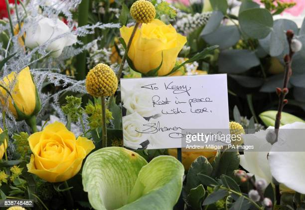 A note on flowers by Sharon Osbourne sits next to the coffin of former X Factor finalist Kerry McGregor at her funeral at the Kirk of Calder in Mid...