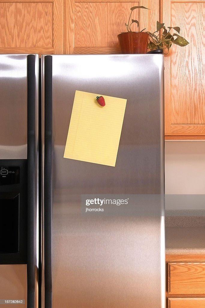 Note on Refrigerator Door : Stock Photo