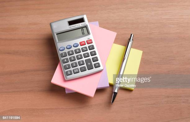 note pad, calculator and pen - budget stock pictures, royalty-free photos & images