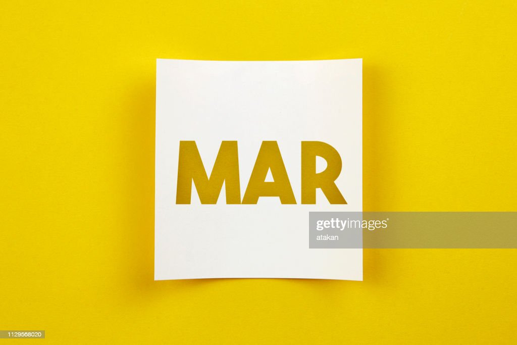 Note paper with March word on it : Stock Photo