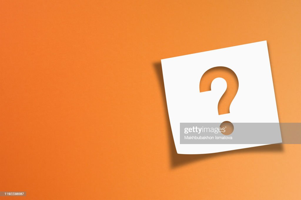 Note paper with question mark on orange background : Stock Photo