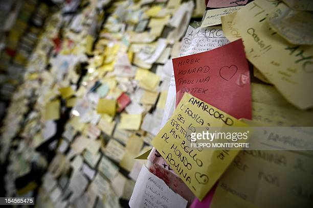 A note reading 'You are the most beautiful thing in the world' is sticked with other notes in remmebrance of the 2009 earthquake are sticked on a...