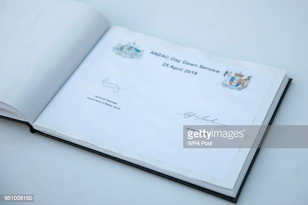 A note signed by Britain's Prince Harry and his US fiancee Meghan Markle is pictured following an Anzac Day dawn service at Hyde Park Corner on April...