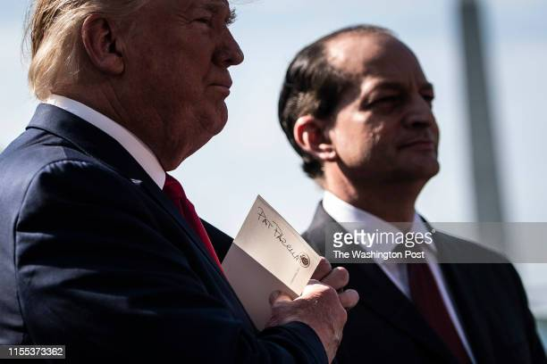 A note with the name of Deputy Secretary of Labor Patrick Pizzella is seen as President Donald J Trump speaks with Labor Secretary Alex Acosta as he...
