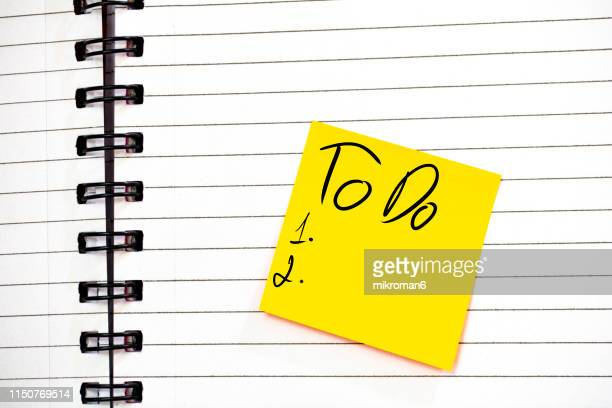 notebook and a note with to do list - to do list stock pictures, royalty-free photos & images