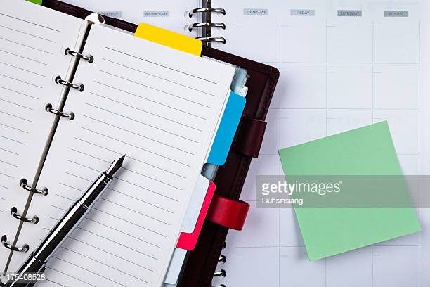 notebook and fountain pen - agenda stock pictures, royalty-free photos & images