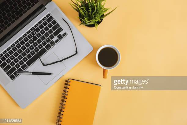 notebook and laptop on work desk - desk stock pictures, royalty-free photos & images