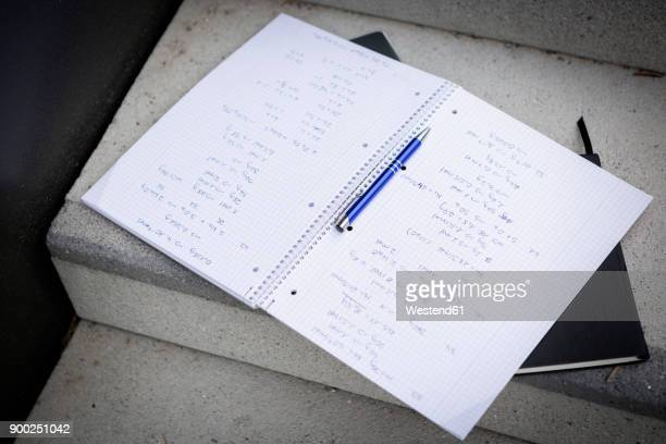 Notebook and roller pen on stairs